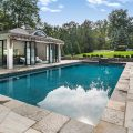 Outdoor pool and entertainment space